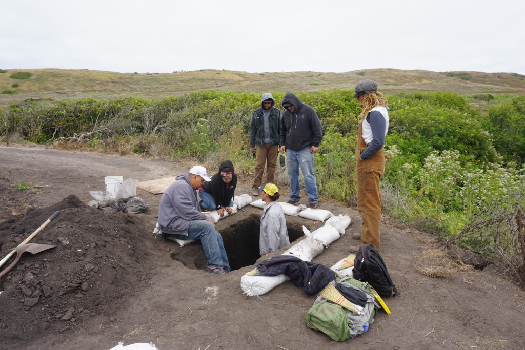 Native Stewards Nathan Vasquez, Vanessa Sanchez, and Josh Higuera-Hood (left to right) work together with Camp Manager Lupe Delgado (second from right) and UCB graduate students Gabriel Sanchez (below) and Michael Grone (far right) to excavate a 2000-4000 year old archaeological site in an agricultural field near Highway 1.