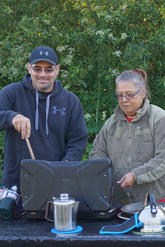 Camp Assistant Lupe Delgado (left) and Camp Director and Amah Mutsun Tribal Elder Eleanor Castro (right) prepare a delicious meal for hungry Native Stewards and students at Wilder Ranch State Park.